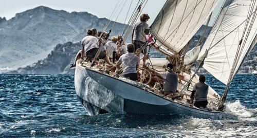 Sailing boat approaching coast line